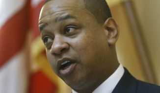 Lt. Gov. Justin Fairfax had to break several tie votes in the Virginia Senate chamber during the floor session inside the State Capitol in Richmond, Va., Wednesday, Feb. 5, 2020. (Bob Brown/Richmond Times-Dispatch via AP)