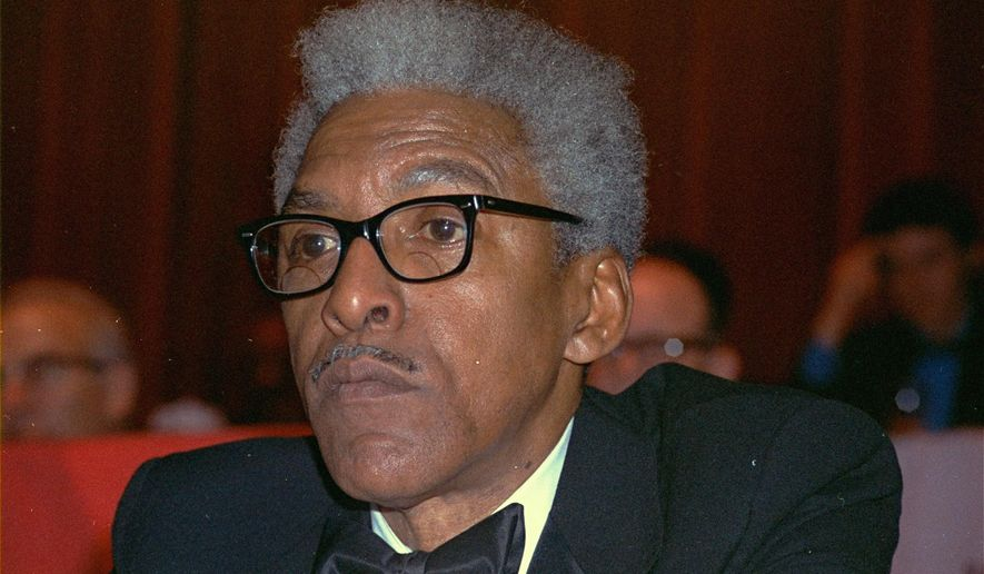 FILE - This Dec. 14, 1970, file photo shows civil rights leader Bayard Rustin at the New York Hilton. California's governor announced Wednesday, Feb. 5, 2020, that he is posthumously pardoning Rustin, a gay civil rights leader, while creating a new pardon process for others convicted under outdated laws punishing homosexual activity. Rustin was a confidant of Dr. Martin Luther King Jr., a key organizer of the March on Washington in 1963, and helped plan other nonviolent protests and boycotts to end racial discrimination. He served 50 days in Los Angeles County jail and had to register as a sex offender before returning to his home state of New York. He died in 1987. (AP Photo/Ron Frehm, File)