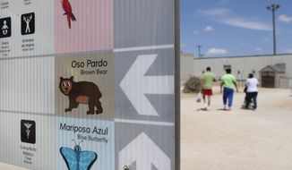 FILE - In this Aug. 23, 2019 file photo, a map using English, Spanish and photos is seen at the ICE South Texas Family Residential Center in Dilley, Texas. A 5-year-old boy from Guatemala who fractured his skull and suffered bleeding around his brain in an accident before entering the ICE South Texas Family Residential Center is not being properly treated for what could be a traumatic brain injury, according to family members and advocates. (AP Photo/Eric Gay, File)