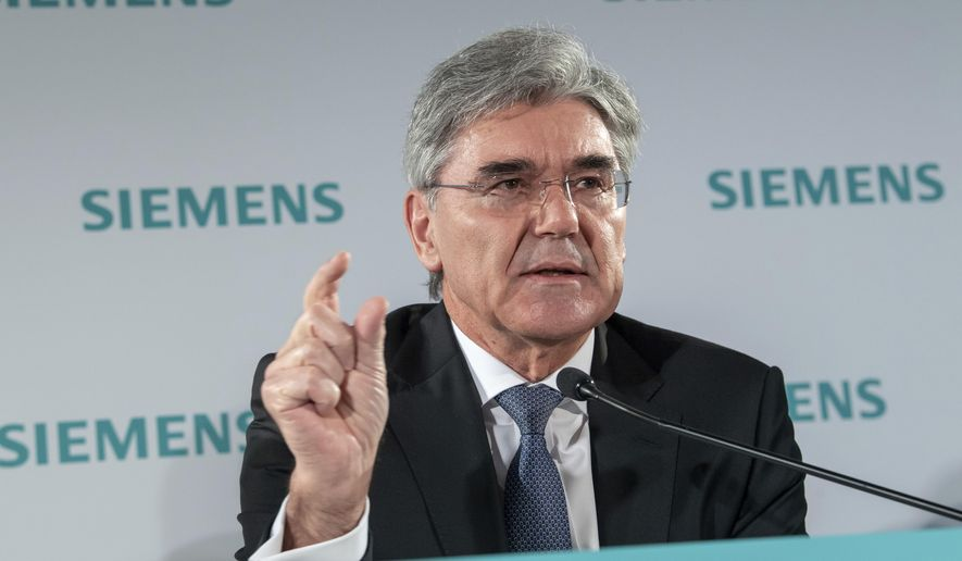 Joe Kaeser, CEO of Siemens, speaks during the Siemens Annual Shareholder's meeting in Munich, Germany, Wednesday, Feb. 5, 2020. Orders and earnings at industrial conglomerate Siemens were lower than a year earlier in the October-December period, the company said Wednesday, weighed down by weaker performances in the auto and energy sectors. (Peter Kneffel/dpa via AP)