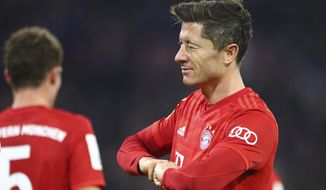 Bayern's Robert Lewandowski winks as he celebrates after scoring his side's fourth goal during the German soccer cup, DFB Pokal, match between FC Bayern Munich and TSG Hoffenheim in Munich, Germany, Wednesday, Feb. 5, 2020. (AP Photo/Matthias Schrader)