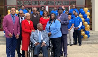 """Former Atlanta Braves slugger Hank Aaron, center, is surrounded by family and friends as Atlanta Technical College celebrates his 86th birthday, Wednesday, Feb. 5, 2020 in Atlanta. Atlanta Technical College renamed an academic complex for the former Atlanta Braves slugger, christening it the Henry Louis """"Hank"""" Aaron Academic Complex. Aaron, a longtime supporter of the college, donates thousands of dollars to the school every year and his Chasing the Dream Foundation awards scholarships to several students. (AP Photo/Ritu Shukla)"""