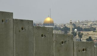 FILE - This July 9, 2004 file photo shows the golden shrine of the Dome of the Rock in Jerusalem's Old city can be seen behind a section made of concrete walls of the controversial separation barrier Israel is building in the village of Abu Dis in the outskirts of Jerusalem. In the 1948 war surrounding Israel's creation, Egyptian forces took control of the Gaza Strip and Jordan took over the West Bank and east Jerusalem. Israel captured the territories when it launched a surprise attack in 1967 at a time of soaring tensions with its hostile Arab neighbors.   (AP Photo/Enric Marti, File)