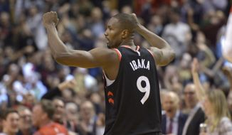 Toronto Raptors center Serge Ibaka (9) reacts after making the winning basket during the second half of an NBA basketball game against the Indiana Pacers, Wednesday, Feb. 5, 2020 in Toronto. (Nathan Denette/The Canadian Press via AP)