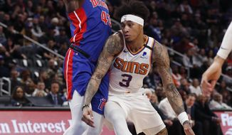 Phoenix Suns forward Kelly Oubre Jr. (3) runs into Detroit Pistons forward Sekou Doumbouya (45) during the first half of an NBA basketball game, Wednesday, Feb. 5, 2020, in Detroit. (AP Photo/Carlos Osorio)