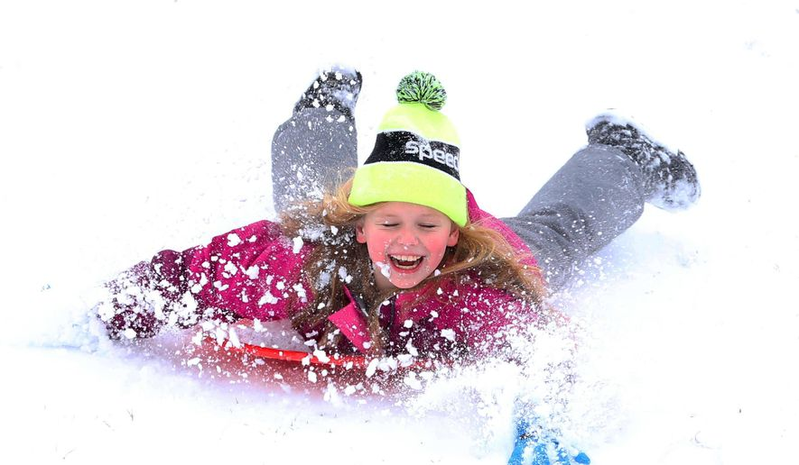 Alice Newhouse, 8, sleds down the snow covered hill next to Will Rogers High School in Tulsa on Wednesday, Feb. 5, 2020 after school was cancelled Wednesday due to a winter storm. . (Tom Gilbert/Tulsa World/Tulsa World via AP) **FILE**