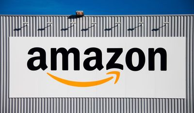 In this Sept. 19, 2013, photo, the Amazon logo is seen on the new logistics center of online merchant Amazon in Lauwin-Planque, northern France. New Zealand announced plans Tuesday, May 1, 2018 to start taxing people who buy books, shoes and other small items online from abroad in a measure many people are calling the Amazon Tax.  (AP Photo/Michel Spingler)