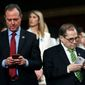 House Impeachment Manager Rep. Adam B. Schiff (left) has been investigating President Trump, his family and businesses, the Trump Organization, over the lawmaker's suspicions of blackmail, money laundering and bribery. (Associated Press)