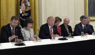 President Donald Trump, center, speaks as he meets with Republican senators on health care in the East Room of at the White House in Washington, Tuesday, June 27, 2017. Seated with him, from left, are Sen. Dean Heller, R-Nev., Sen. Susan Collins, R-Maine, Sen. Lisa Murkowski, R-Alaska, Sen. Orrin Hatch, R-Utah, Sen. Cory Gardner, R-Colo. (AP Photo/Susan Walsh) **FILE**