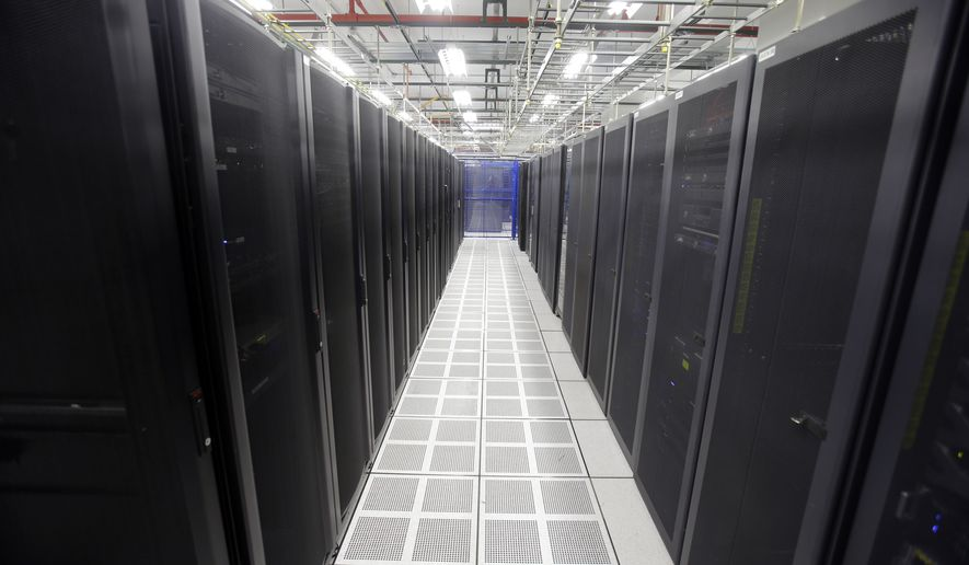 In this Aug. 29, 2014, file photo, rows of servers are lined up at BlueBridge Networks in Cleveland. The company, which has a data center near Playhouse Square in downtown Cleveland and a larger facility in suburban Mayfield Heights, is one of the growing number of data centers are choosing to locate in and around the city. (AP Photo/Mark Duncan)