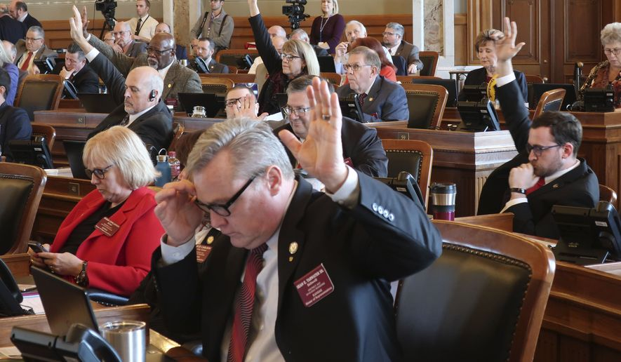 Republicans in the Kansas House indicate that they want a roll call vote on giving first-round approval to a proposed amendment to the state constitution on abortion, Thursday, Feb. 6, 2020, at the Statehouse in Topeka, Kan. The amendment would overturn a Kansas Supreme Court decision protecting abortion rights and has advanced to a final vote. (AP Photo/John Hanna)