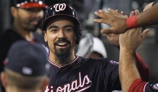 In this Oct. 9, 2019, file photo, Washington Nationals' Anthony Rendon celebrates in the dugout after scoring on a single by Juan Soto during the sixth inning in Game 5 of the baseball team's National League Division Series against the Los Angeles Dodgers in Los Angeles. (AP Photo/Mark J. Terrill) ** FILE **