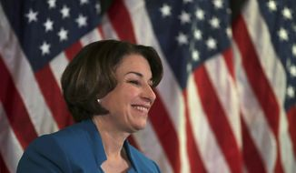 Democratic presidential candidate Sen. Amy Klobuchar, D-Minn., smiles during a campaign stop in Manchester, N.H., Thursday, Feb. 6, 2020. (AP Photo/Charles Krupa)