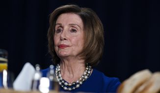 Speaker of the House Nancy Pelosi of Calif., listens as President Donald Trump speaks at the 68th annual National Prayer Breakfast, at the Washington Hilton, Thursday, Feb. 6, 2020, in Washington. (AP Photo/ Evan Vucci)