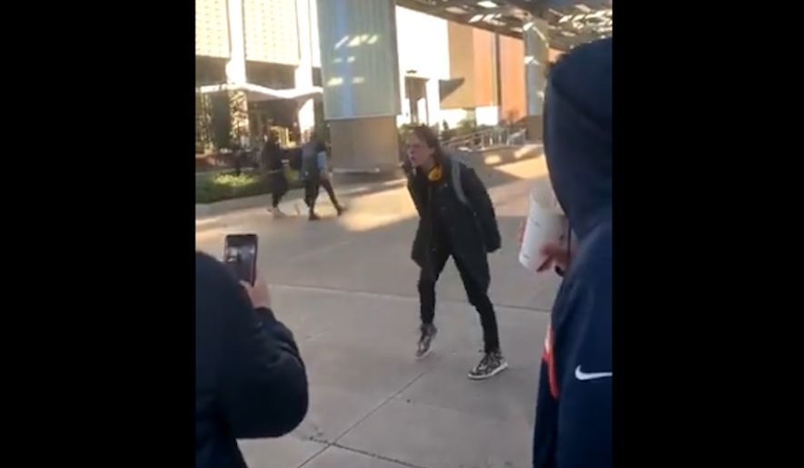 """Authorities at Arizona State University are investigating a video apparently recorded on campus that shows a man screaming, """"Slash Republican throats!"""" (@sft_asu video screengrab)"""