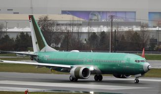 FILE - In this Dec. 11, 2019, file photo, a Boeing 737 Max being built for Norwegian Air International taxis for a test flight, at Renton Municipal Airport in Renton, Wash. Boeing has found a new problem with changes it is making to software on the 737 Max, but the company says the issue will not further delay the grounded plane's return to flight. The head of the Federal Aviation Administration, Stephen Dickson, discussed the issue Thursday, Feb. 6, 2020 with reporters in London.  (AP Photo/Ted S. Warren, File)