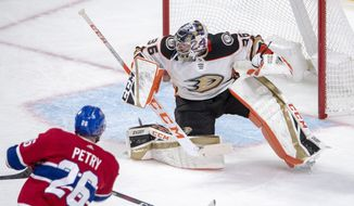 Montreal Canadiens defenseman Jeff Petry (26) scores on Anaheim Ducks goaltender John Gibson (36) during overtime in an NHL hockey game Thursday, Feb. 6, 2020, in Montreal. (Ryan Remiorz/The Canadian Press via AP)
