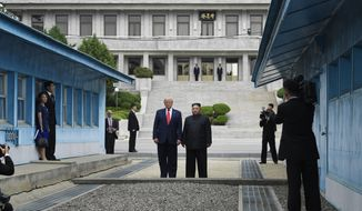 FILE - In this June 30, 2019, file photo, President Donald Trump meets with North Korean leader Kim Jong Un at the border village of Panmunjom in the Demilitarized Zone, South Korea. (AP Photo/Susan Walsh, File)