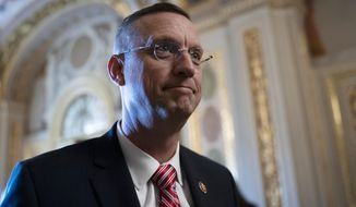 In this Jan. 29, 2020 file photo, Rep. Doug Collins, R-Georgia, the ranking member of the House Judiciary Committee, at the Capitol in Washington, Wednesday, Jan. 29, 2020. Both Sen. Kelly Loeffler and Rep. Doug Collins were in the audience as Trump spoke for more than an hour at the White House, where the 2020 election rivals were among a number of GOP lawmakers the president thanked by name for supporting him throughout his impeachment that ended with his acquittal Wednesday by the Senate. (AP Photo/J. Scott Applewhite, File)
