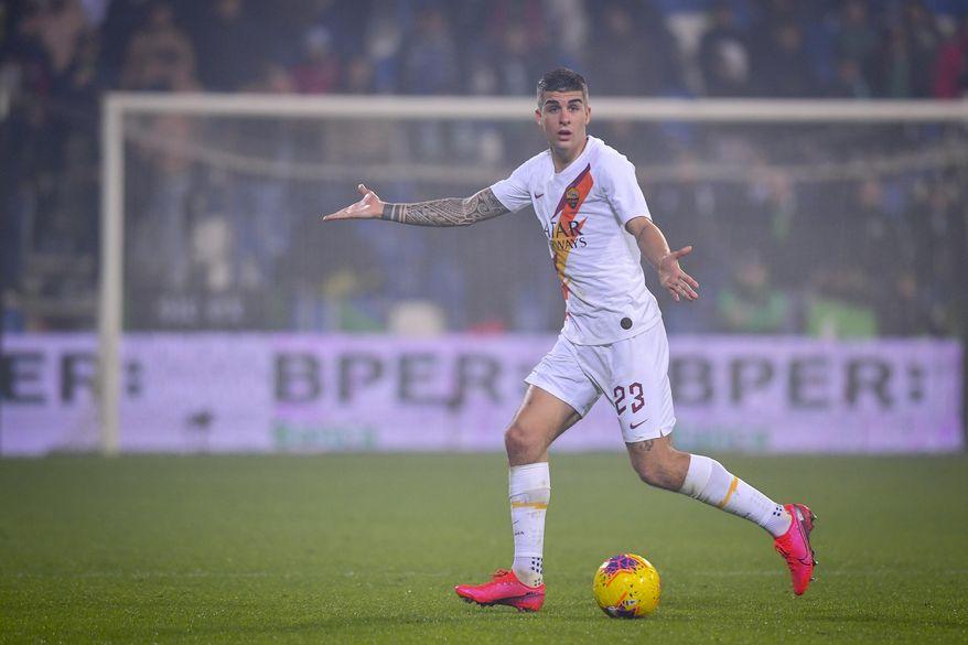 Roma's Gianluca Mancini gestures during a Serie A soccer match between Roma and Sassuolo, in Reggio Emilia, Italy, Saturday, Feb. 1, 2020. (Fabio Rossi/LaPresse via AP)