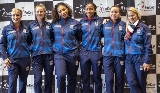 The United States Fed Cup team, from left, Bethanie Mattek-Sands, Alison Riske,  Serena Williams, Coco Gauf,  Sofia Kenin, and team captain Kathy Rinaldi pose during the draw for their Fed Cup tennis matches against Latvia, Thursday, Feb. 6, 2020 at Angel of the Winds Arena in Everett, Wash., (Dean Rutz/The Seattle Times via AP)