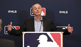 MLB Commissioner Rob Manfred answers questions at a press conference during MLB baseball owners meetings, Thursday, Feb. 6, 2020, in Orlando, Fla. (AP Photo/John Raoux) **FILE**