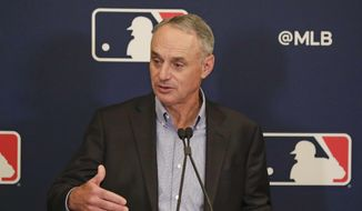 MLB Commissioner Rob Manfred answers questions at a press conference during MLB baseball owners meetings, Thursday, Feb. 6, 2020, in Orlando, Fla. (AP Photo/John Raoux) ** FILE **