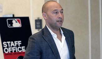 Derek Jeter CEO and part owner of the Miami Marlins leaves a meeting during MLB baseball owners meetings, Thursday, Feb. 6, 2020, in Orlando, Fla. (AP Photo/John Raoux)