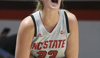 North Carolina State's Elissa Cunane (33) celebrates in the final minutes of the team's NCAA college basketball game against Virginia Tech on Thursday, Feb. 6, 2020, in Blacksburg, Va. (Matt Gentry/The Roanoke Times via AP)