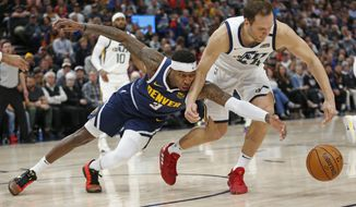 Denver Nuggets forward Torrey Craig (3) and Utah Jazz forward Bojan Bogdanovic (44) battle for a loose ball in the first half during an NBA basketball game Wednesday, Feb. 5, 2020, in Salt Lake City. (AP Photo/Rick Bowmer)