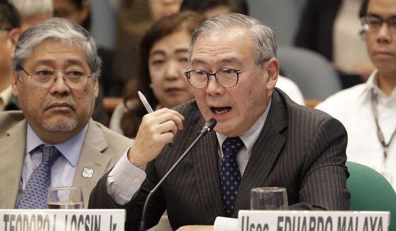 Philippine Secretary of Foreign Affairs Teodoro Locsin Jr. gestures during a Senate hearing in Manila, Philippines on Thursday, Feb. 6, 2020. (AP Photo/Aaron Favila) ** FILE **
