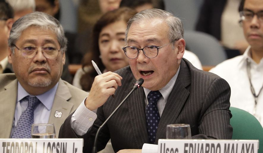 Philippine Secretary of Foreign Affairs Teodoro Locsin Jr. gestures during a senate hearing in Manila, Philippines on Thursday, Feb. 6, 2020. The Philippine foreign secretary warned Thursday that abrogating a security accord with Washington would undermine his country's security and foster aggression in the disputed South China Sea. (AP Photo/Aaron Favila)