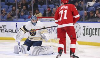 Buffalo Sabres goalie Jonas Johansson (34) stops Detroit Red Wings forward Dylan Larkin (71) during the second period of an NHL hockey game Thursday, Feb. 6, 2020, in Buffalo, N.Y. (AP Photo/Jeffrey T. Barnes)