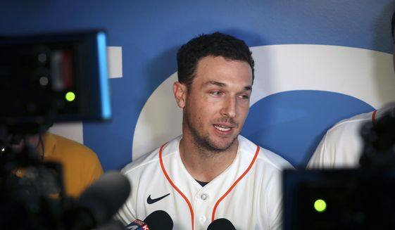 Houston Astros' Alex Bregman is interviewed by the media during the baseball team's FanFest, Saturday,  Jan. 18, 2020, in Houston. (Steve Gonzales/Houston Chronicle via AP)