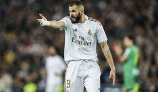 Real Madrid's Karim Benzema reacts during a Spanish Copa del Rey soccer match between Real Madrid and Real Sociedad at the Santiago Bernabeu stadium in Madrid, Spain, Thursday, Feb. 6, 2020. (AP Photo/Manu Fernandez)
