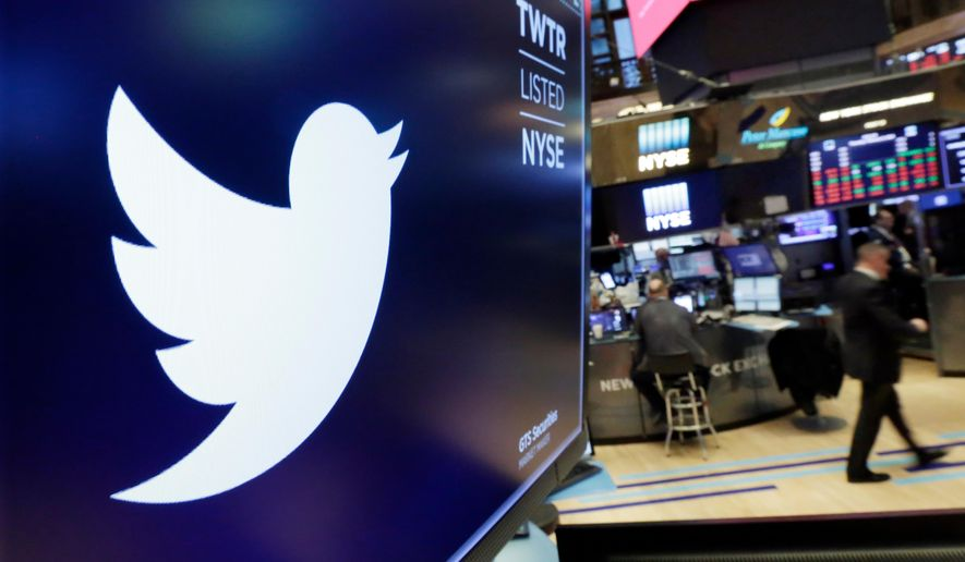 In this Feb. 8, 2018, file photo, the logo for Twitter is displayed above a trading post on the floor of the New York Stock Exchange. Twitter reports earnings Thursday, Oct. 25. Twitter reported Thursday, Feb. 6, 2020 that its fourth-quarter net earnings fell to $119 million from $255 million in the same period a year earlier but the number of daily users rose. (AP Photo/Richard Drew, File) **FILE**