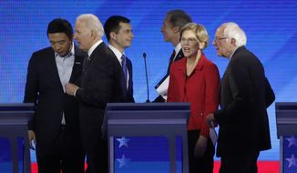 From left, Democratic presidential candidates entrepreneur Andrew Yang, former Vice President Joe Biden, former South Bend, Ind., Mayor Pete Buttigieg, businessman Tom Steyer, Sen. Elizabeth Warren, D-Mass., and Sen. Bernie Sanders, I-Vt., depart the stage after a Democratic presidential primary debate, Friday, Feb. 7, 2020, hosted by ABC News, Apple News, and WMUR-TV at Saint Anselm College in Manchester, N.H. (AP Photo/Elise Amendola)