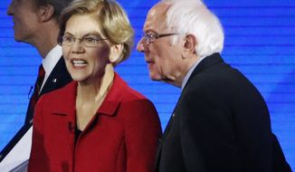 Sen. Elizabeth Warren, D-Mass., left, and Sen. Bernie Sanders, I-Vt., leave the stage after a Democratic presidential primary debate, Friday, Feb. 7, 2020, hosted by ABC News, Apple News, and WMUR-TV at Saint Anselm College in Manchester, N.H. (AP Photo/Elise Amendola)