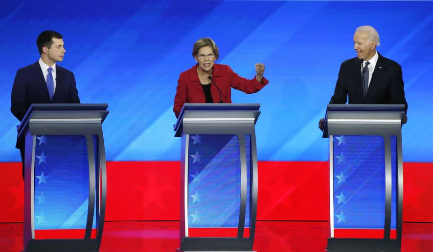 Democratic presidential candidate Sen. Elizabeth Warren, D-Mass., center, speaks as former South Bend, Ind., Mayor Pete Buttigieg, left, and former Vice President Joe Biden listen during a Democratic presidential primary debate, Friday, Feb. 7, 2020, hosted by ABC News, Apple News, and WMUR-TV at Saint Anselm College in Manchester, N.H. (AP Photo/Elise Amendola)