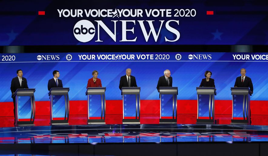 From left, Democratic presidential candidates entrepreneur Andrew Yang, former South Bend Mayor Pete Buttigieg, Sen. Bernie Sanders, I-Vt., former Vice President Joe Biden, Sen. Elizabeth Warren, D-Mass., Sen. Amy Klobuchar, D-Minn., and businessman Tom Steyer participate Friday, Feb. 7, 2020,in a Democratic presidential primary debate hosted by ABC News, Apple News, and WMUR-TV at Saint Anselm College in Manchester, N.H. (AP Photo/Elise Amendola)