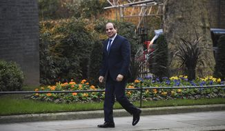 Egypt's President Abdel Fattah el-Sisi arrives at 10 Downing Street, in London, Tuesday, Jan. 21, 2020, for a bilateral meeting with Britain's Prime Minister Boris Johnson. (AP Photo/Alberto Pezzali)