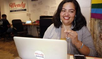FILE - In this Sept. 29, 2017 file photo, Wendy Carrillo, then a candidate for California State Assembly District 51, calls voters at her campaign headquarters in Los Angeles. The leader of California's state Assembly on Friday, Feb. 7, 2020, formally reprimanded an assemblywoman and her chief of staff for inappropriate behavior, an unwanted hug and kiss from the assemblywoman and coarse sexual comments from her top aide. Assembly Speaker Anthony Rendon chastised Assemblywoman Wendy Carrillo, a fellow Democrat from the Los Angeles area, in the reprimand letters to her and chief of staff George Esparza. He ordered both to undergo training or coaching on appropriate workplace conduct. The letters are dated Thursday but were released Friday, along with a heavily redacted incident report. (AP Photo/Damian Dovarganes)