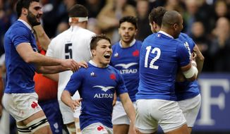 France players with Roman Ntamack, center, celebratre their opening try during the Six Nations rugby union international match between France and England at the Stade de France in Paris, Sunday, Feb. 2, 2020. (AP Photo/Christophe Ena)