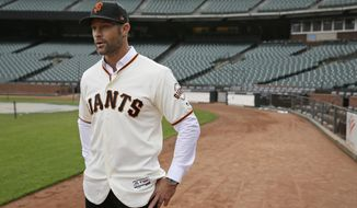 FILE - In this Nov. 13, 2019, file photo, San Francisco Giants manager Gabe Kapler stands on the field and looks out at Oracle Park in San Francisco after being introduced. Kapler knew from the get-go when named San Francisco's new manager the pressure he would feel taking over as leader of a franchise that has had so many good ones in recent memory. (AP Photo/Eric Risberg, File)