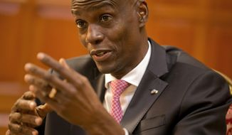 Haiti's President Jovenel Moise speaks during an interview at his home in Petion-Ville, a suburb of Port-au-Prince, Haiti, Friday, Feb. 7, 2020. Moise said Friday he wanted a new constitution to stipulate that presidential proposals would automatically pass if the National Assembly did not vote them up or down within 60 days. (AP Photo/Dieu Nalio Chery)