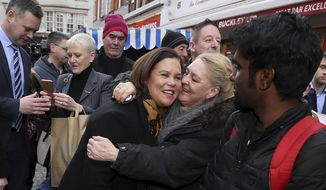 Sinn Fein leader Mary Lou McDonald, center, is greeted by well wishers during a walkabout in central Dublin during a walkabout in central Dublin, whilst on the General Election campaign trail on Thursday, Feb. 6, 2020. Ireland goes to the polls for a general election on Feb. 8. (Brian Lawless/PA via AP)