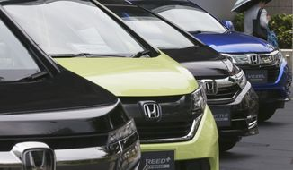 FILE - In this July 31, 2019, file photo, Honda cars are displayed at the automaker's headquarters in Tokyo. Japanese automaker Honda reported Friday, Feb. 7, 2020 a nearly 31% dive in its October-December profit as strong demand for its motorcycles failed to make up for falling vehicles sales. (AP Photo/Koji Sasahara, File)