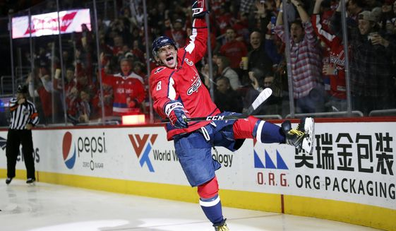 In this March 12, 2018, file photo, Washington Capitals left wing Alex Ovechkin celebrates his goal in the second period of an NHL hockey game against the Winnipeg Jets, Monday,, in Washington. It was Ovechkin's 600th career goal. Ovechkin is on the verge of becoming the eighth player in NHL history to score 700 career goals.  (AP Photo/Alex Brandon) ** FILE **