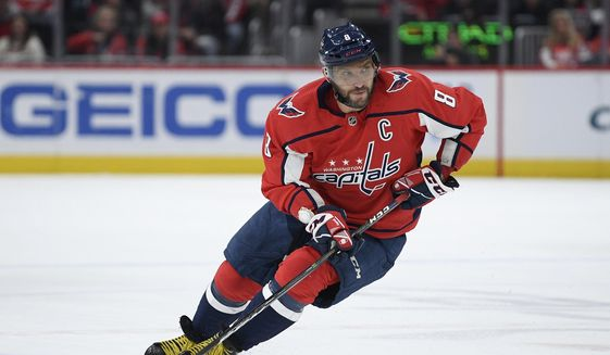 In this Jan. 7, 2020, file photo ,Washington Capitals left wing Alex Ovechkin (8), of Russia, skates with the puck during the first period of an NHL hockey game against the Ottawa Senators in Washington. Ovechkin is on the verge of becoming the eighth player in NHL history to score 700 career goals. (AP Photo/Nick Wass) ** FILE **
