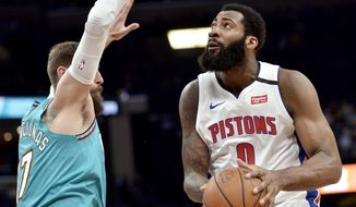 Detroit Pistons center Andre Drummond (0) handles the ball against Memphis Grizzlies center Jonas Valanciunas (17) in the first half of an NBA basketball game Monday, Feb. 3, 2020, in Memphis, Tenn. (AP Photo/Brandon Dill)